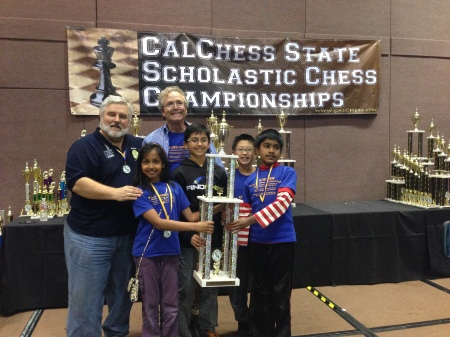 Calchess President Tom Langland(left) with MSJE head coach Joes Lonsdale and the k-5 State Championship Team from MSJE.